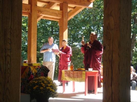 Rinpoche consecrating Buddha statue.
